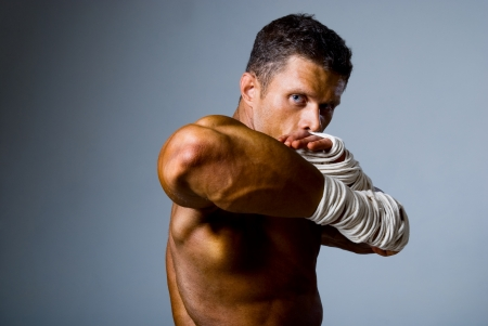 Portrait of a kick boxer in fighting stance. Elbow in the foreground Stock Photo - 17232179