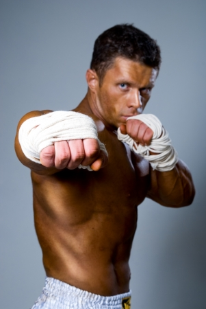 forearms: fighter punching. A fist in the foreground, the person not in focus