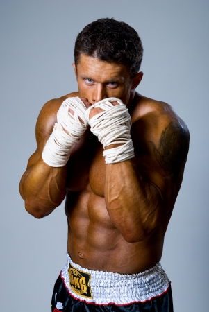 Portrait of the fighter. Isolated. Kickboxing or muay thai photo