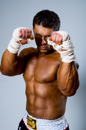 forearms: Kick-boxer in fighting stance with his hands up Stock Photo