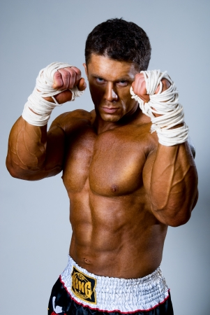Kick-boxer in fighting stance with his hands up Stock Photo - 17232202