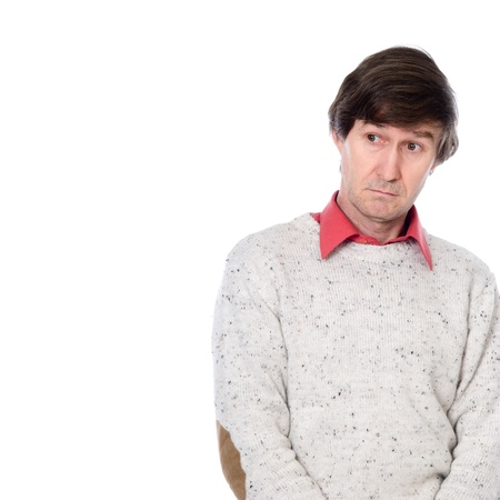 Portrait of a man in a sweater with a stupid look on his face. The man looks away. Isolated on white background Stock Photo - 17344772