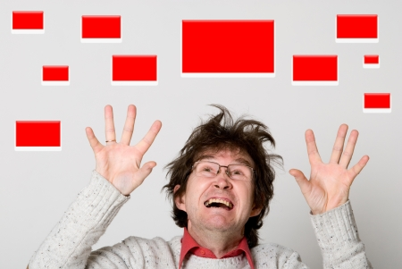 Shocked man choosing red buttons. Stock Photo - 17405445
