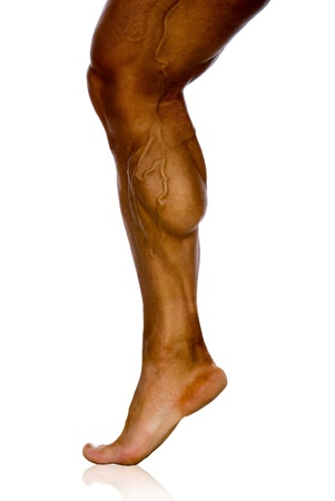 knees bent: musculature of male athletes leg on a white background Stock Photo