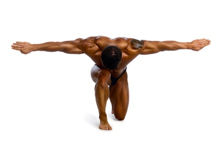 Muscular man with outstretched arms to the side. isolated on a white background