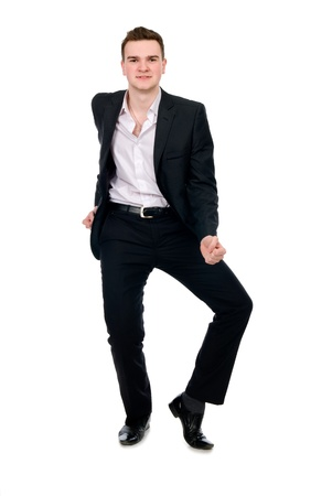 Young businessman in suit dancing. Isolated on white background photo