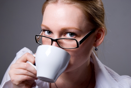 Young Businesswoman Drinking Coffee. Coffee Break photo
