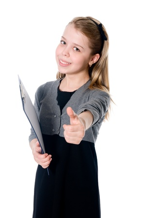 Young girl showing thumb up. Isolated on white background. photo