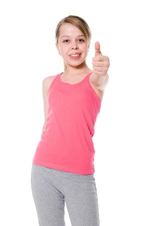 Happy girl shows thumb OK. Winning in sports.  Isolated on white background photo