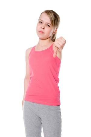 Young girl gesturing thumbs down over white. Stock Photo - 18963218