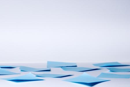 assert: Light background with sticks lying on the floor. Stock Photo