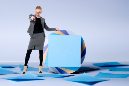 assert: Young business woman showing a finger at the camera. Standing at billboard Stock Photo