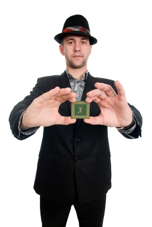The man in the hat showing a microchip computer, shot in studio photo