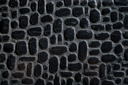 Old synthetic leather with black knobs, background photo