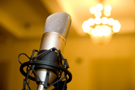 equipment: Microphone in the conference hall. Background blurred chandelier Stock Photo