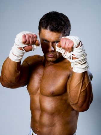 kickboxer: Kick-boxer in fighting stance with his hands up Stock Photo