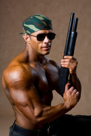 Strong athletic man with a gun. Special Forces soldiers photo