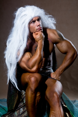 deplorable: Handsome muscular man in a pose of a thinker. The athlete with long white hair.