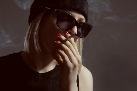 bad habit: Young girl smoking a cigarette, bad habit depression
