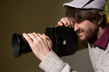 Man with retro camera shoots the film stress. photo