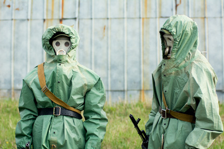 Soldiers in their masks and protective clothing.  photo