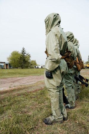 A group of soldiers with guns in their masks and protective clothing. military exercises