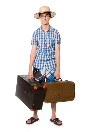 Young, handsome man in glasses with two bags ready to travel. The stereotype of a foolish novice traveler. Portrait of a traveler in a full-length isolated on white background photo