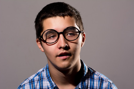 mathematician: Close-up portrait of a young man with a tired, silly facial expression.