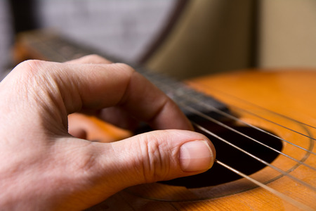 fingertips: Acoustic guitar guitarist playing. Musical instrument with performer hands. Artist art song.