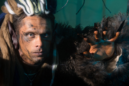 dark elf: Close-up portrait of a man with dreadlocks in the skin.