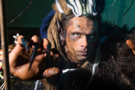 Close-up portrait of a man with dreadlocks in the skin. photo