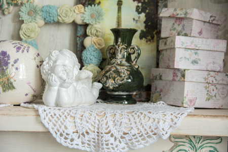 recollections: Vintage table with an angel and boxes for gifts. Background for romantic cards