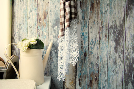 Interior rural veranda with watering can and old walls. Background in grunge style with curtain