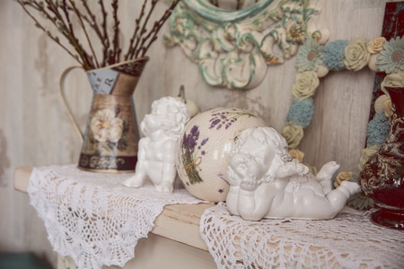 recollections: Vintage table with two angels, clocks and knitted cloth. retro.