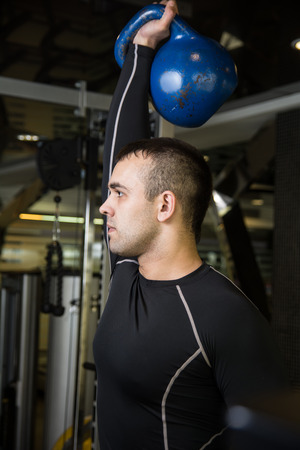 abdominal wall: Kettlebell swing workout training man at gym.