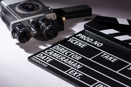 Old camera with two lenses and a movie clapperboard. Preparations for shooting movie