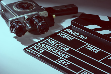 Old movie camera with film clapperboard. Preparations for shooting movie