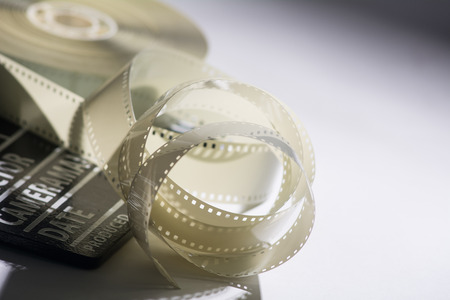 Closeup of a spool of film into a movie and slapstick. Stock Photo
