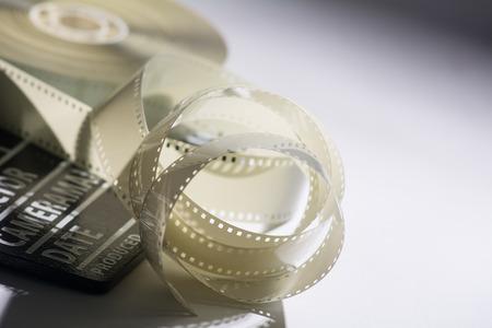 Closeup of a spool of film into a movie and slapstick. Stock Photo