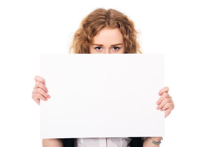promotional: Young woman eyes over a blank promotional display isolated on a white background. Stock Photo