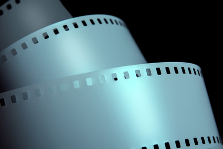 negative film: Strips of negative film strip on a dark background. Advertise new film