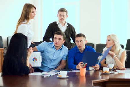 young entrepreneurs: Young entrepreneurs at a business meeting in the office. business discussion