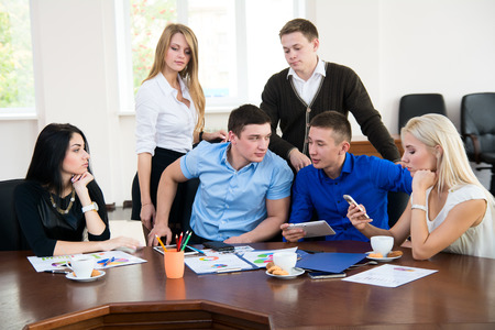 teamwork business: Young businessmen  at a business meeting. Teamwork in the office