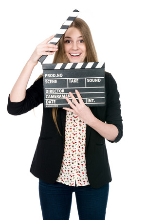 beautiful smile: Beautiful smiling woman holding a movie clapper. Cheerful girl helps in shooting a movie. Isolated on a white background