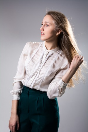 and the magnificent: Beauty portrait of a young beautiful blonde girl with long straight flying hair. Magnificent hair.