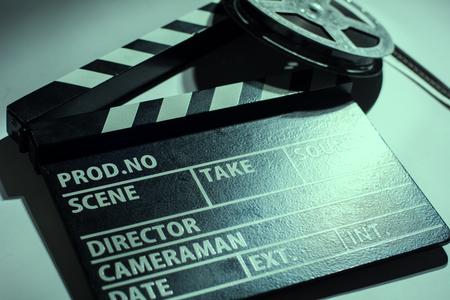 movie reel: Close-up of cinema clap and film reel with. Background for movie shooting advertising Stock Photo
