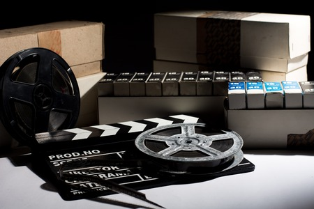 clap: Reel with film and cinema clap. Old film in boxes