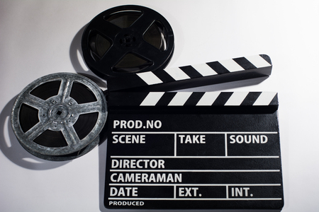 clap: Clap movie on a light background. Metal or plastic film coil. Objects for shooting movies and demonstrations Stock Photo