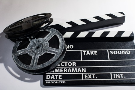 movies: Clap movie on a light background. Metal or plastic film coil. Objects for shooting movies and demonstrations Stock Photo