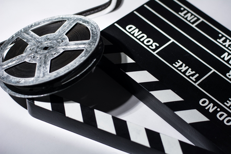 clap: Clap movie on a light background. Metal reel of film Stock Photo